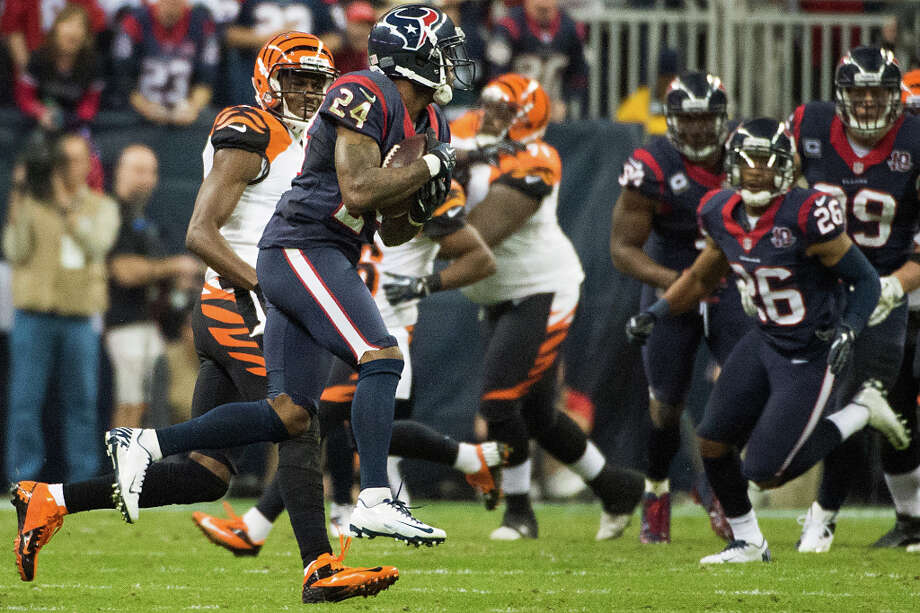 Texans cornerback Johnathan Joseph (24) intercepts a pass intended for Bengals wide receiver A.J. Green during the third quarter. Photo: Smiley N. Pool, Houston Chronicle / © 2013  Houston Chronicle