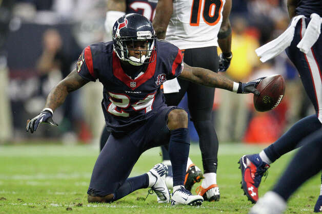 Texans cornerback Johnathan Joseph (24) celebrates after his interception during the third quarter. Photo: Karen Warren, Houston Chronicle / © 2012 Houston Chronicle