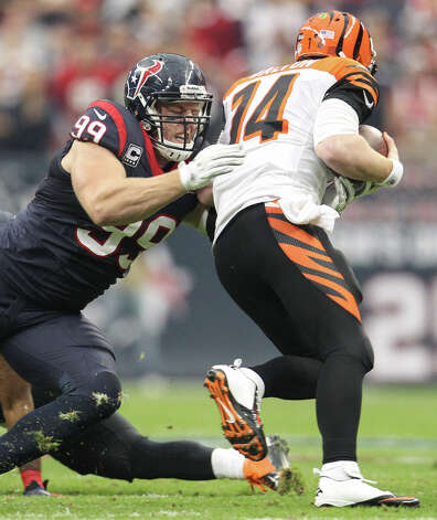 Texans defensive end J.J. Watt (99) sacks Bengals quarterback Andy Dalton (14) during the first quarter. Photo: Karen Warren, Houston Chronicle / © 2012 Houston Chronicle