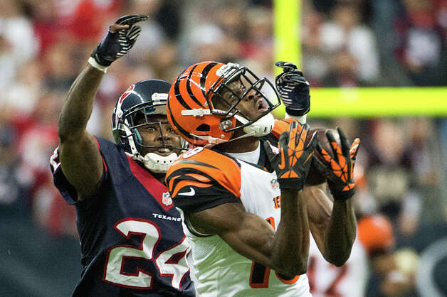 Bengals wide receiver A.J. Green (18) beats Texans cornerback Johnathan Joseph (24) on a 45-yard reception during the third quarter. Photo: Smiley N. Pool, Houston Chronicle / © 2013  Houston Chronicle
