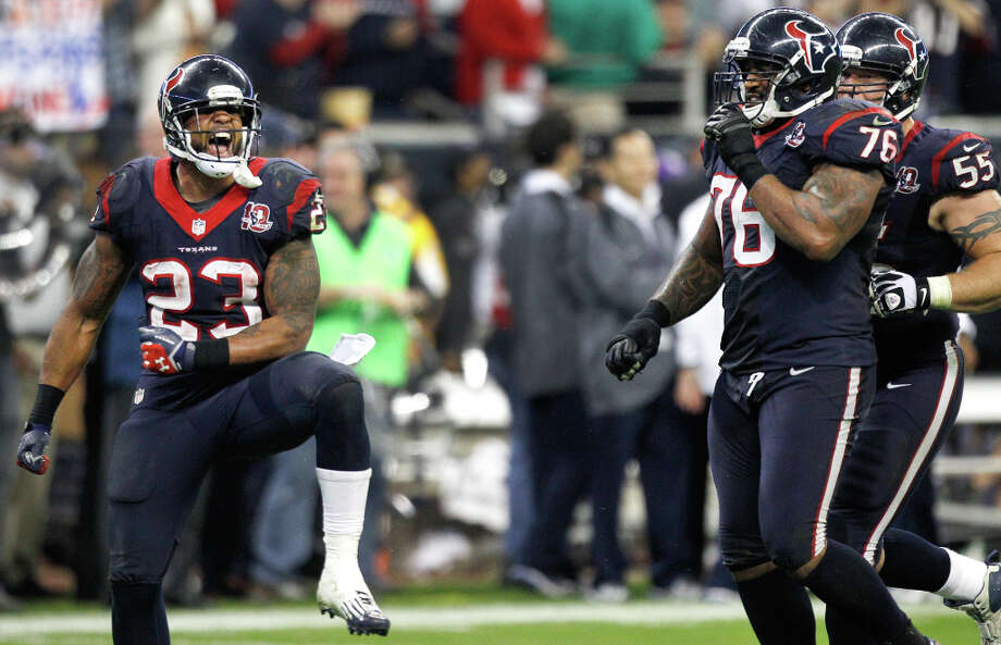 Houston Texans running back Arian Foster (23) celebrates, after picking up a first down that allowed the Texans to run out the clock against the Cincinnati Bengals, with teammates Duane Brown (76) and Chris Myers (55) during the fourth quarter of an AFC playoff game at Reliant Stadium on Saturday, Jan. 5, 2013, in Houston. Photo: Brett Coomer, Houston Chronicle / © 2013  Houston Chronicle