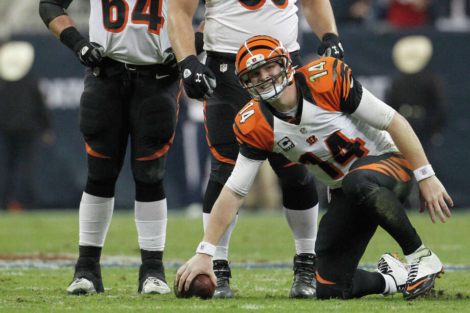 Bengals quarterback Andy Dalton (14) gets up slowly after being tackled during the fourth quarter. Photo: Karen Warren, Houston Chronicle / © 2012 Houston Chronicle