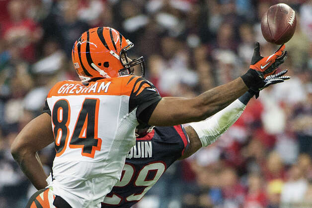 Texans strong safety Glover Quin (29) breaks up a pass intended for Bengals tight end Jermaine Gresham (84) during the first half. Photo: Smiley N. Pool, Houston Chronicle / © 2013  Houston Chronicle