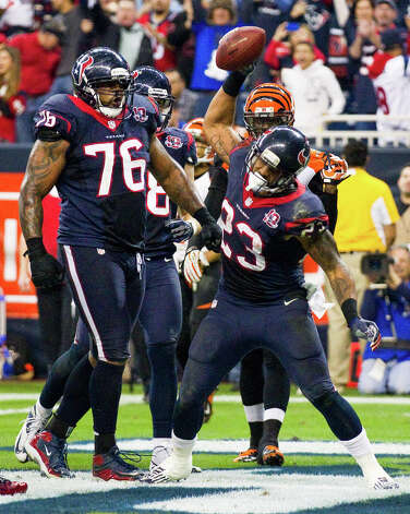 Houston Texans running back Arian Foster (23) celebrates his 1-yard touchdown run against the Cincinnati Bengals during the third quarter of an AFC playoff game at Reliant Stadium on Saturday, Jan. 5, 2013, in Houston. Photo: Brett Coomer, Houston Chronicle / © 2013  Houston Chronicle