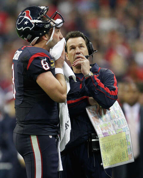 Texans quarterback Matt Schaub (8) confers with head coach Gary Kubiak during a time out in the thir