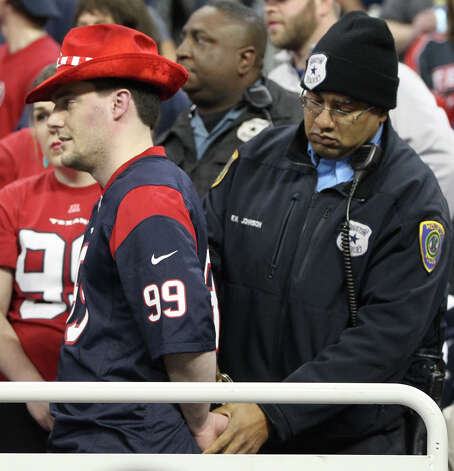 A fan is arrested in the stands during the fourth quarter. Photo: Karen Warren, Houston Chronicle / © 2012 Houston Chronicle