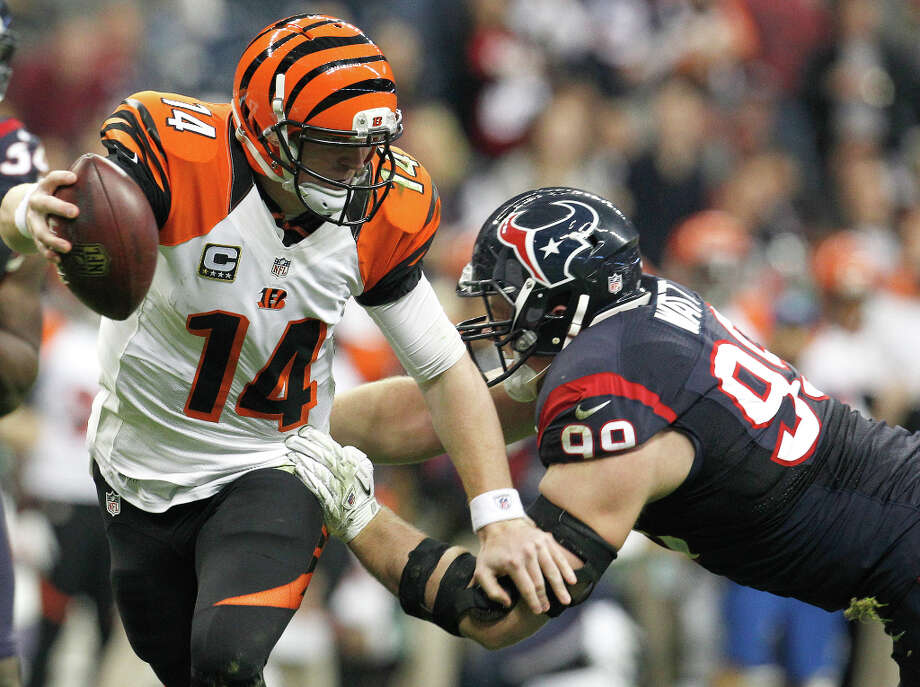 Bengals quarterback Andy Dalton (14) is sacked by Texans defensive end J.J. Watt (99) during the third quarter. Photo: Karen Warren, Houston Chronicle / © 2012 Houston Chronicle