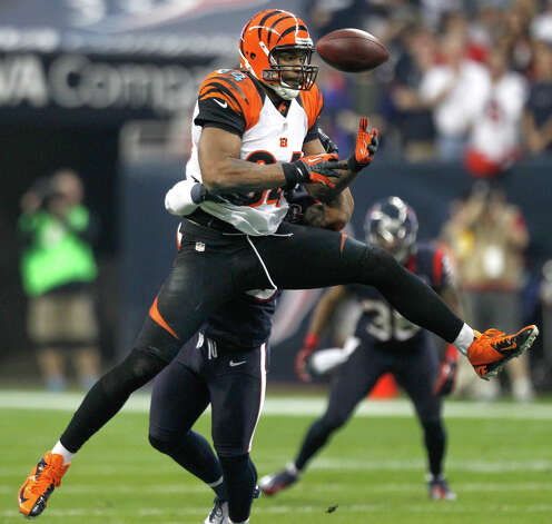 Cincinnati Bengals tight end Jermaine Gresham (84) has the ball knocked away by Houston Texans free safety Danieal Manning during the second quarter of an AFC playoff game at Reliant Stadium on Saturday, Jan. 5, 2013, in Houston. Photo: Brett Coomer, Houston Chronicle / © 2013  Houston Chronicle