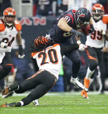 Texans tight end Owen Daniels (81) is tackled by Bengals free safety Reggie Nelson (20) during the first quarter. Photo: Karen Warren, Houston Chronicle / © 2012 Houston Chronicle