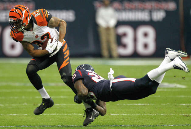 Houston Texans cornerback Kareem Jackson (25) tackles Cincinnati Bengals wide receiver Marvin Jones (82) during the second quarter of an AFC playoff game at Reliant Stadium on Saturday, Jan. 5, 2013, in Houston. Photo: Brett Coomer, Houston Chronicle / © 2013  Houston Chronicle