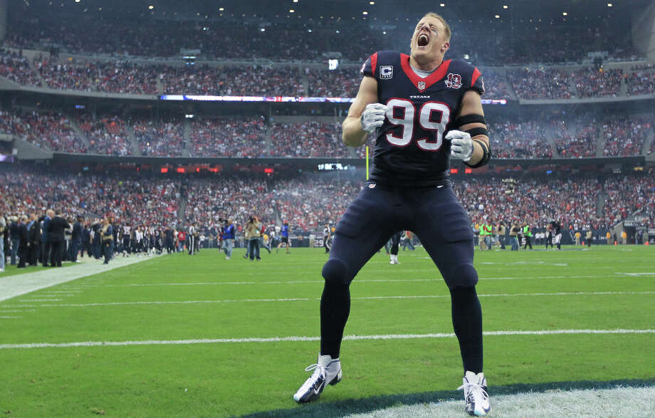 Texans defensive end J.J. Watt screams to the fans before the game. Photo: Karen Warren, Houston Chronicle / © 2012 Houston Chronicle