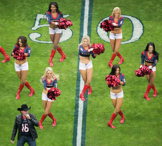 Clay Walker performs with the Texans cheerleaders before the game. Photo: Smiley N. Pool, Houston Chronicle / © 2013  Houston Chronicle