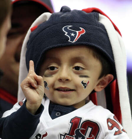 Matthew Medina, 5, of Houston, does his impersonation of Texans defensive end J.J. Watt's signature finger wag before the game. Photo: Karen Warren, Houston Chronicle / © 2012 Houston Chronicle