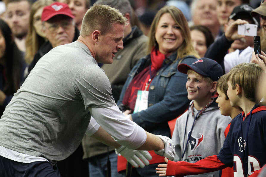 Texans defensive end J.J. Watt greets the crowd on the sidelines as he warms up before the game.