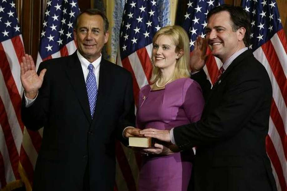 House Speaker John Boehner of Ohio performs a mock swearing in Thursday for Rep. Luke Messer, R-Ind., on Capitol Hill in Washington, as the 113th Congress began. (AP Photo)