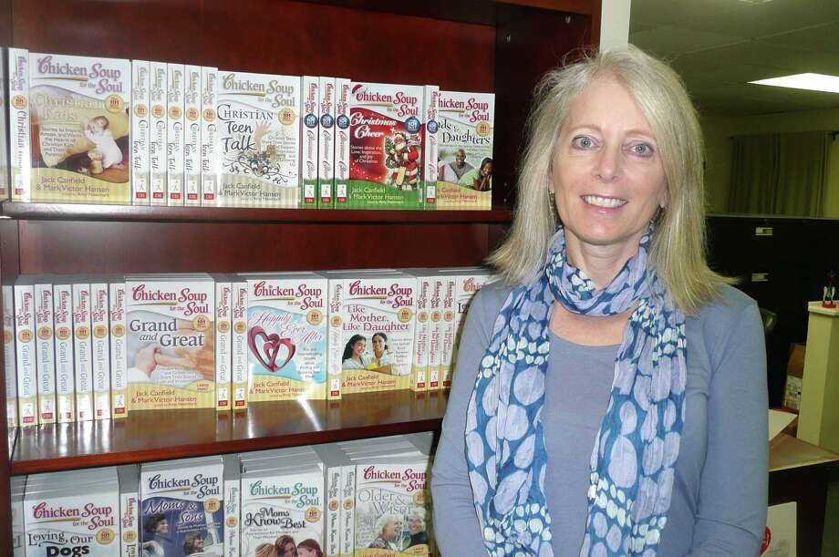 "Amy Newmark, seen here in her editorial office in Cos Cob, is publisher of the ever-expanding ""Chicken Soup for the Soul"" books.  Newmark says there are currently 250 titles in the series. Photo: Anne W. Semmes"