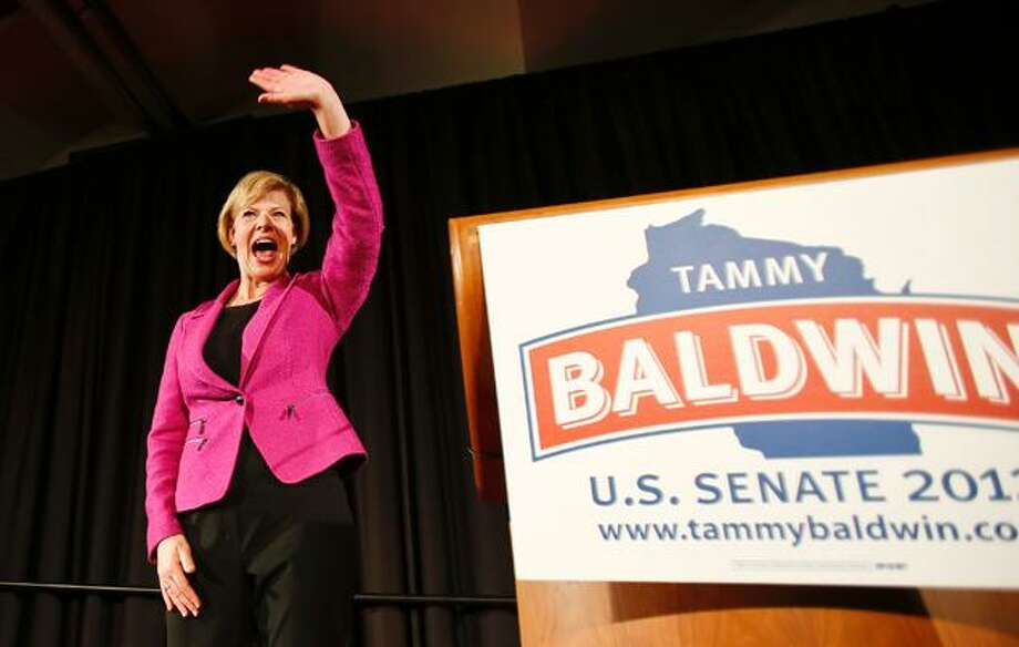 Sen. Tammy Baldwin, D-Wis., waves to supporters after making her a victory speech in Wisconsin's U.S. Senate race.  (Andy Manis / AP Photo)