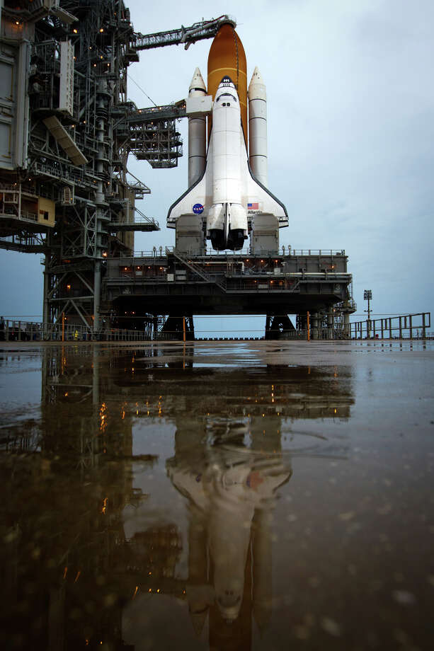 July 7, 2011 | The space shuttle Atlantis sits on a launch pad covered with puddles in a light rain at the Kennedy Space Center. Photo: Smiley N. Pool, Houston Chronicle / © 2011  Houston Chronicle