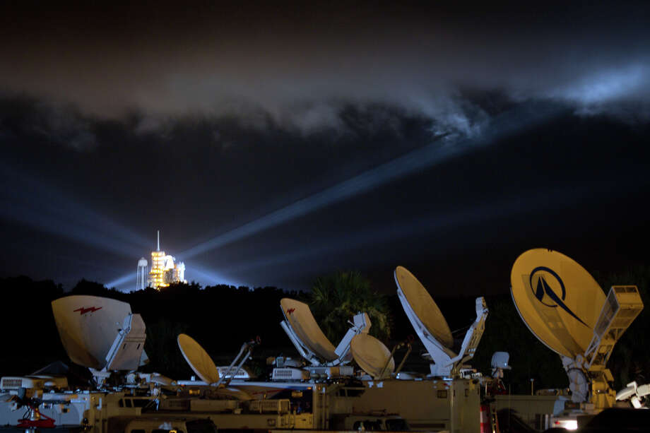 July 7, 2011 | A sea of television uplink trucks is seen in the foreground as the space shuttle Atlantis sits at launch pad 39A on the eve of the final shuttle launch. Photo: Smiley N. Pool, Houston Chronicle / © 2011  Houston Chronicle