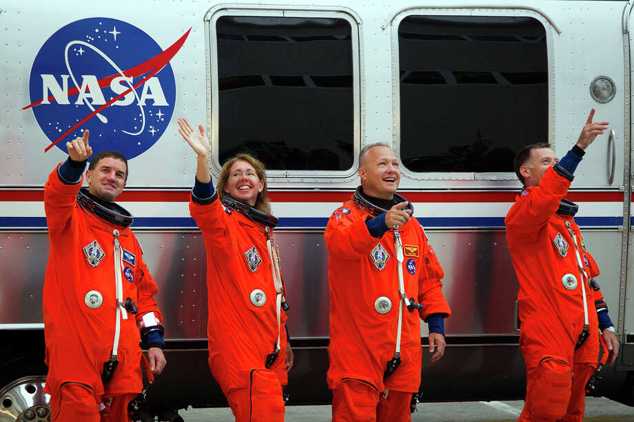 July 8, 2011 |  Rex Walheim, Sandy Magnus, pilot Doug Hurley and commander Chris Ferguson head to the Astrovan during the crew walkout for the final space shuttle mission. Photo: Smiley N. Pool, Houston Chronicle / © 2011  Houston Chronicle