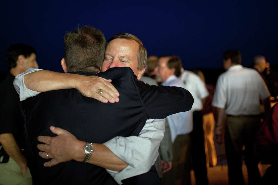 July 21, 2011 | Shuttle launch director Mike Leinbach, facing, hugs LeRoy Cain, deputy space shuttle program manager, after the space shuttle Atlantis landed for the final time. Photo: Smiley N. Pool, Houston Chronicle / © 2011  Houston Chronicle