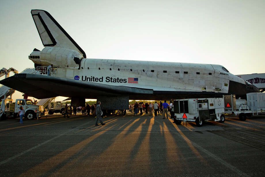 July 21, 2011 | The sun rises behind the the space shuttle Atlantis after landing at the Kennedy Space Center in Florida completing STS-135. Photo: Smiley N. Pool, Houston Chronicle / © 2011  Houston Chronicle