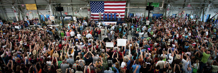 July 22, 2011 | A large crowd of supporters welcomes home the crew of STS-135 during a ceremony for the crew of the space shuttle Atlantis at Ellington Field in Houston. Photo: Smiley N. Pool, Houston Chronicle / © 2011  Houston Chronicle