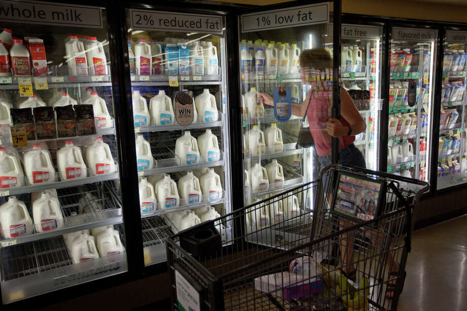 July 30, 2011 | Sandy Magnus, STS-135 mission specialist, shops for groceries to restock her kitchen following the final space shuttle mission.  The the crew had their share of minor household challenges while they were away: broken lawn equipment, broken water pipes, dead car batteries and flat tires. Photo: Smiley N. Pool, Houston Chronicle / © 2011  Houston Chronicle