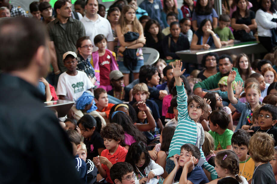 Aug. 16, 2011 | Children raise their hands to ask a question of the crew during an event at the American Museum of Natural History in New York. Photo: Smiley N. Pool, Houston Chronicle / © 2011  Houston Chronicle