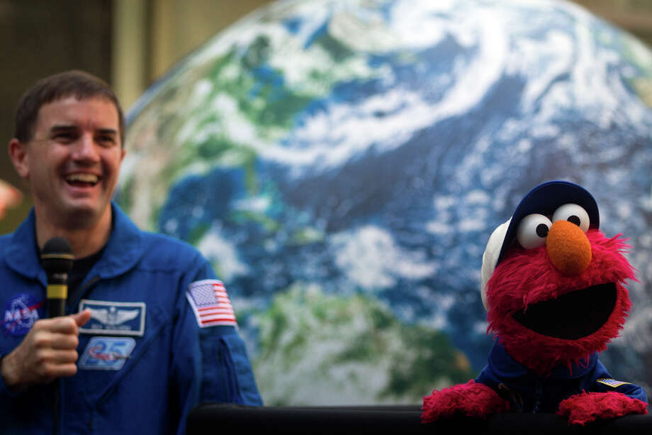 Aug. 17, 2011 |  Rex Walheim appears with Sesame Street character Elmo during an event at the Eventi Hotel in New York. Photo: Smiley N. Pool, Houston Chronicle / © 2011  Houston Chronicle