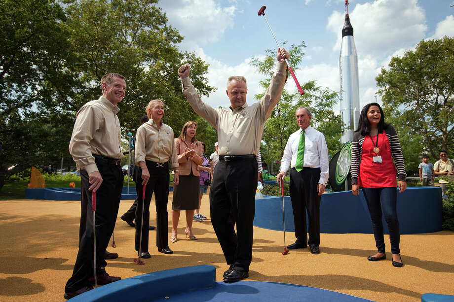 Aug. 17, 2011 | Doug Hurley celebrates after winning a hole of miniature golf against New York Mayor Michael Bloomberg. Photo: Smiley N. Pool, Houston Chronicle / © 2011  Houston Chronicle