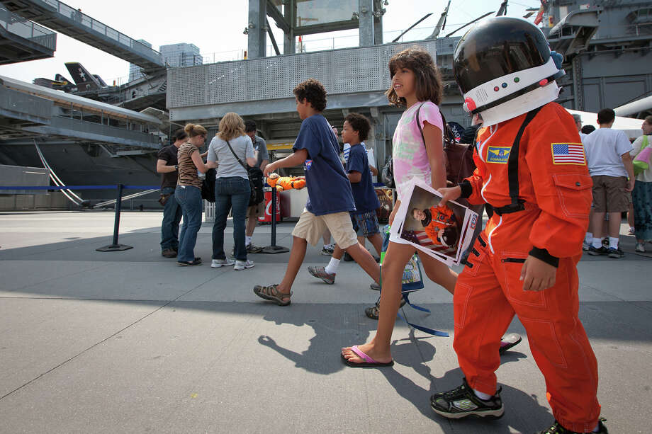 Aug. 18, 2011 | Youngsters depart the Intrepid Sea, Air and Space Museum clutching freshly autographed photos of the STS-135 crew. Photo: Smiley N. Pool, Houston Chronicle / © 2011  Houston Chronicle