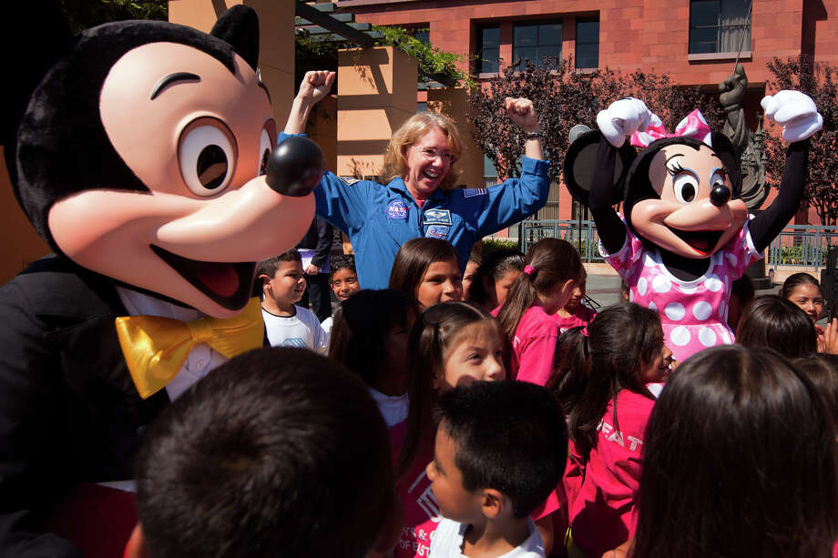 Aug. 24, 2011 |  Sandy Magnus clowns around with Mickey Mouse and Minney Mouse during a visit to The Walt Disney Studios in Burbank, Calif.  The crew greeted kids from the East Los Angeles Boys & Girls Club and gave a presentation on the final shuttle mission. Photo: Smiley N. Pool, Houston Chronicle / © 2011  Houston Chronicle