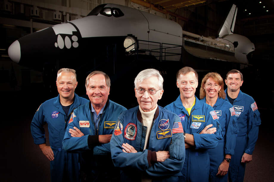 Nov. 2, 2011 | The astronauts who formed the crews of STS-1, the first space shuttle mission, and STS-135, the final shuttle mission, pose for a group photo at the Johnson Space Center.   The are, from left, Doug Hurley, STS-135 pilot, John Young, STS-1 commander, Robert Crippen, STS-1 pilot, with STS-135 commander Chris Ferguson,  mission specialist Sandy Magnus and mission specialist NASA astronaut Rex Walheim. Photo: Smiley N. Pool, Houston Chronicle / © 2011  Houston Chronicle