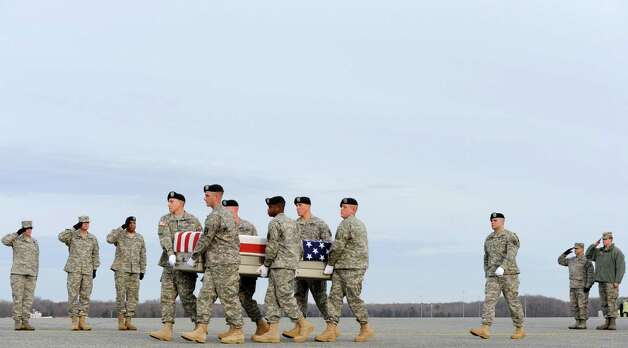 An Army carry team moves a transfer case containing the remains of Pfc. Markie T. Sims, Monday at Dover Air Force Base, Del. According to the Department of Defense, Sims, 20, of Citra, Fla., died Saturday in the Panjwai district of Kandahar province, Afghanistan, of wounds sustained when enemy forces attacked his unit with an improvised explosive device. Photo: AP