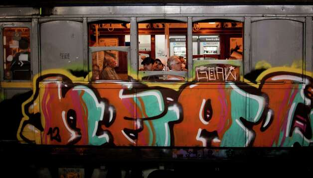 "Passengers travel in a wooden carriage car on the historic subway system, Line A, in Buenos Aires, Argentina, on Wednesday. The city government announced that the almost 100-year-old 'La Brugeoise""wooden carriages will be replaced in a short time by modern Chinese units. Photo: AP"