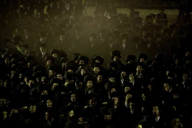 Ultra-Orthodox Jews gather in the men's section for a traditional Jewish wedding of the great-grandson of the Rabbi of the Sanz Hasidic dynasty, in Netanya, Israel, on Wednesday. Thousands of people attended the wedding. Photo: AP