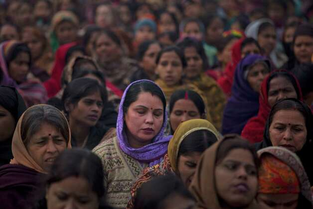 Indian women offer prayers for a gang rape victim at Mahatma Gandhi memorial in New Delhi, India, on Wednesday. India's top court says it will decide whether to suspend lawmakers facing sexual assault charges as thousands of women gathered at the memorial to independence leader Mohandas K. Gandhi to demand stronger protection for their safety. Photo: AP