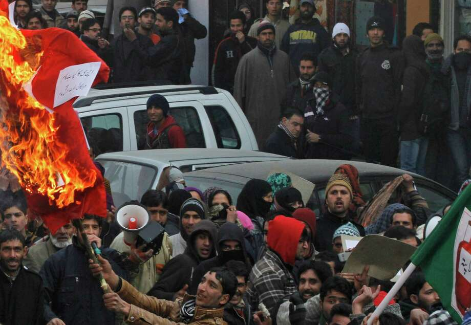 An activist of the opposition People's Democratic Party (PDP) burns an effigy of the state government during a protest in Srinagar, India, on Saturday.  The protest was against corruption and price rise of essential commodities. Photo: AP