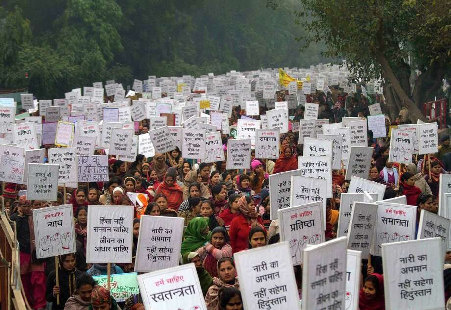 "Indian women carry placards as they march to mourn the death of a gang rape victim in New Delhi, India, on Wednesday. India's top court says it will decide whether to suspend lawmakers facing sexual assault charges as thousands of women gathered at the memorial to independence leader Mohandas K. Gandhi to demand stronger protection for their safety. The banners read ""India won't tolerate women's insult and We want respect not violence in life."" Photo: AP"