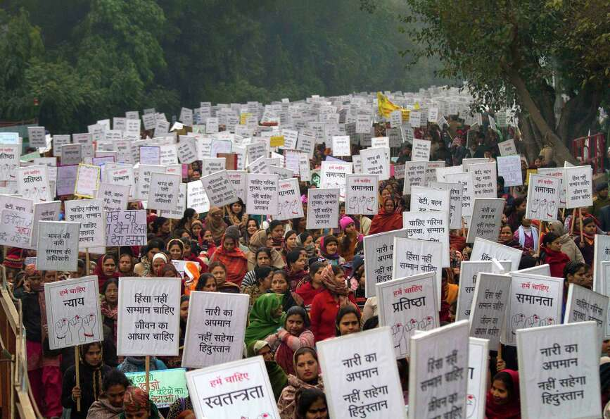 Indian women carry placards as they march to mourn the death of a gang rape victim in New Delhi, Ind