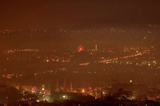 Haze of smoke hangs over the city scape in Athens, early Thursday. The cloud is the result of a massive switch to wooden stoves and fireplaces for heating as many households, already hard hit by the economic crisis, can not afford to buy heating oil after the cash-strapped government decided to harmonize taxes on heating oil and diesel fuel, leading to a 40 percent  rise in the price of heating oil. Photo: AP