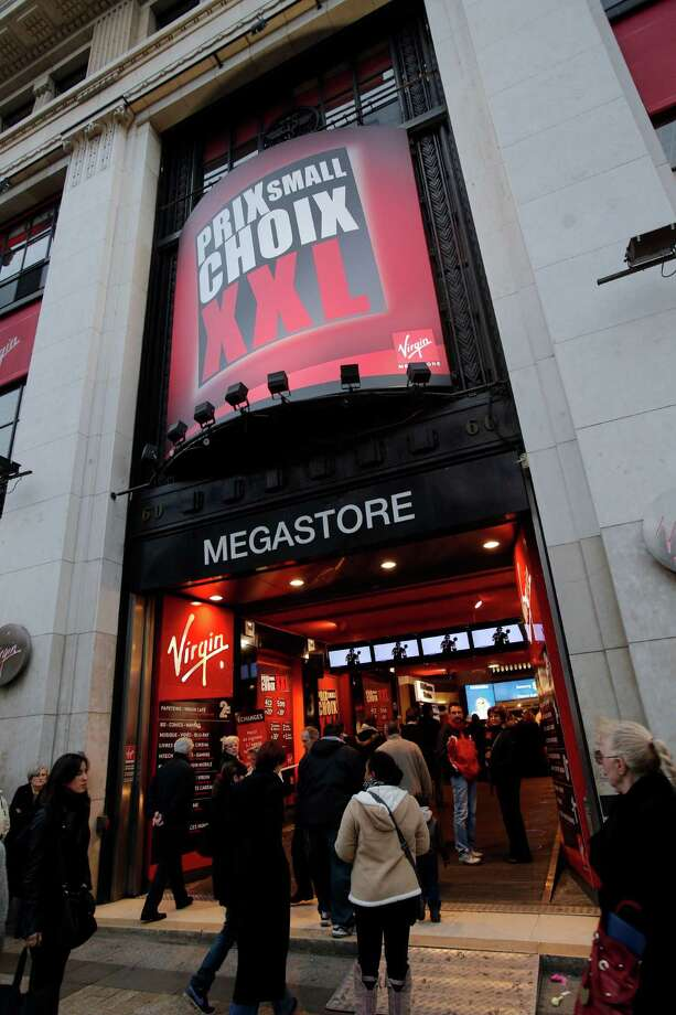 The Virgin Megastore on the Paris Champs Elysees avenue, on Saturday in Paris.  The entertainment retailer Virgin France currently owned by Butler Capital declared itself insolvent and is planning to shut its stores according to an announcement on Friday. Photo: AP