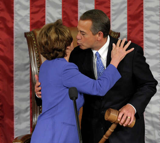 House Minority Leader Nancy Pelosi of Calif. gets a kiss from House Speaker John Boehner of Ohio after he was re-elected as House Speaker as the 113th Congress began, Thursday on Capitol Hill in Washington. Photo: AP