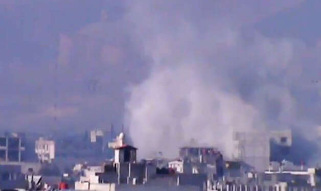 In this image taken from video obtained from the Shaam News Network, which has been authenticated based on its contents and other AP reporting, smoke rises from buildings due to heavy shelling in Damascus countryside, Syria, on Wednesday. Photo: AP