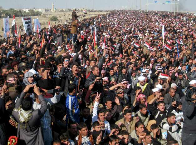 "Protesters chant slogans against the Iraq's Shiite-led government as they wave national flags during a demonstration in Fallujah, 40 miles (65 kilometers) west of Baghdad, Iraq, on Friday. About 3,000 people gathered in the northern city of Mosul, where they called for the release of female prisoners and to end to what they say are random arrests of Sunnis. Among their chants were: ""Down, down with al-Maliki"" and ""No to sectarianism."" In the ethnically mixed city of Kirkuk, about 1,000 protested to demand the release of Sunni detainees. Protests were also reported in the Sunni strongholds of Fallujah and Tikrit. Photo: AP"
