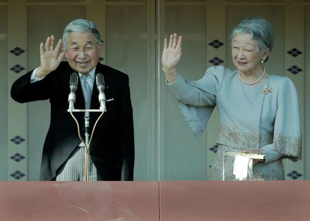Emperor Akihito, left,  and Empress Michiko show at a balcony as they acknowledge to well-wishers for the new year's celebrations at the Imperial Palace in Tokyo on Wednesday. Thousands of people from across the country turned out at the palace to greet Emperor and the Imperial family for the new year. Photo: AP