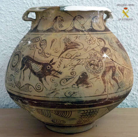 In this picture released by the Spanish Interior Ministry on Saturday  a very rare vase from late second century BC that was seized by police after it was found in an antique shop in the town of El Campello, eastern Spain.  Officers seized the object during a routine inspection and arrested the shop owner for allegedly receiving and handling the plundered antiquity of almost incalculable historical importance.  The vase is nearly 22-centuries old and was allegedly taken from an Iberian era archeological site in the Spanish province of Alicante. (AP Photo/Interior Ministry) Eds note: Logo at top right put on by source. Photo: AP