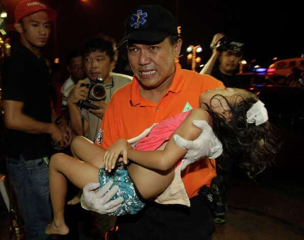 A rescue worker carries 7-year-old Stephanie Nicole Ella at the East Avenue Medical Center in suburban Quezon city, north of Manila, Philippines on Tuesday. Ella died in a hospital Wednesday after being hit in the head by a stray bullet during New Year's Eve revelry in the Philippines, heightening calls to halt one of Asia's most violent celebrations of the new year. Photo: AP
