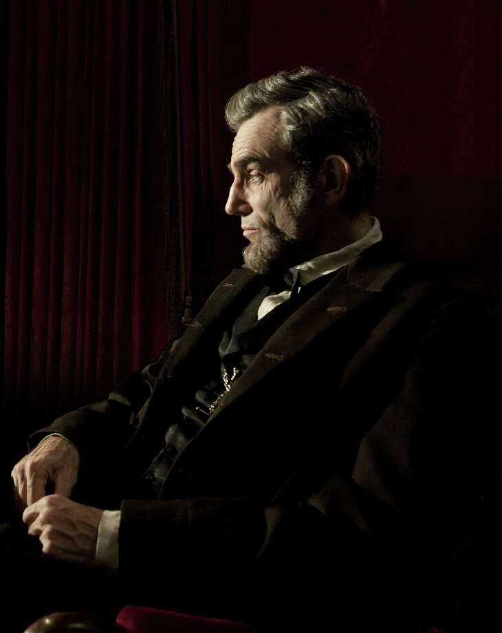 """""""Lincoln"""" and """"Zero Dark Thirty"""" are adding to their front-runner status for Hollywood's awards season. The two dramas earned nominations from the Writers Guild on Friday for outstanding screen writing. Above is a publicity film image released by DreamWorks and Twentieth  Century Fox shows Daniel Day-Lewis portraying Abraham Lincoln in the  film """"Lincoln."""" Photo: AP"""